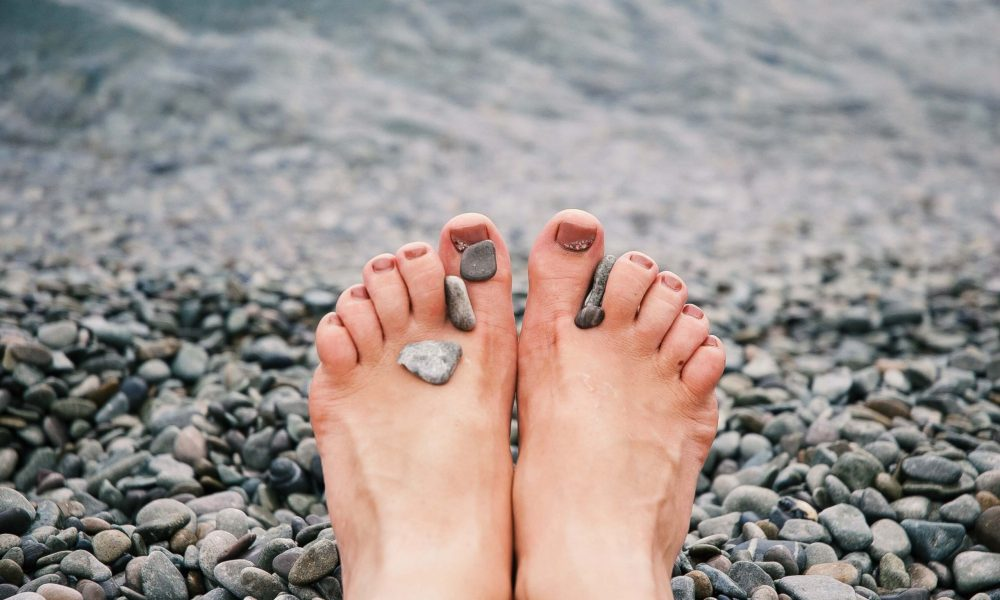 stones-on-woman-s-feet-1274061